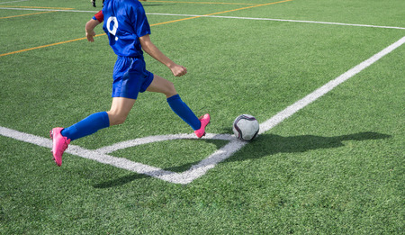 corner kick soccer: Soccer Corner Kick on a Green Grass Field