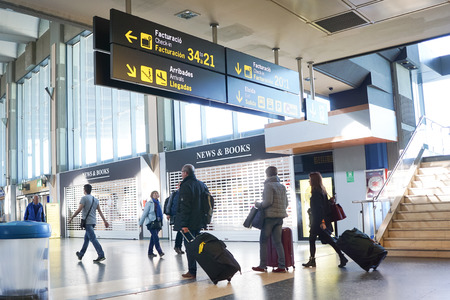 VALENCIA, SPAIN - FEBRUARY 20, 2016: Airline passengers in the Valencia Airport. About 4.59 million passengers passed through the airport in 2015.