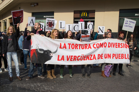 bull ring: VALENCIA, SPAIN - MARCH 14, 2016: Unidentified protesters in an anti bullfighting demonstrating across the street from the Valencia Bull Ring. Bullfighting currently takes place in nine countries around the world.