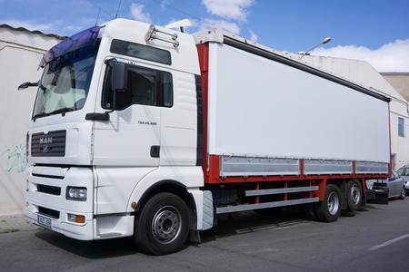 providers: VALENCIA, SPAIN - MARCH 10, 2016: A MAN Truck on the streets of Valencia. MAN Truck and Bus company is headquartered in Munich, Germany and is one of the leading international providers of commercial vehicles.