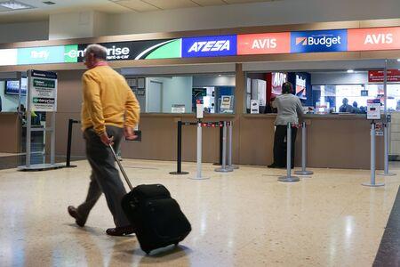 hertz: VALENCIA, SPAIN - APRIL 21, 2016: Rental car counter at the Valencia Airport. Approximately 4.98 million passengers passed through the Valencia airport in 2015. Editorial