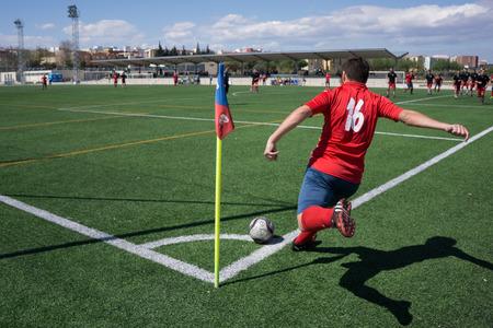 corner kick soccer: Valencia, Spain - April 10, 2016: An unkown soccer player takes a corner kick during a mens soccer league game.