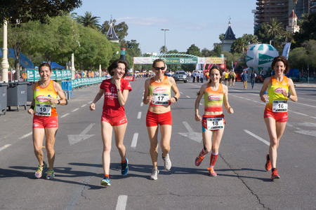 isabel: VALENCIA, SPAIN - MAY 15, 2016: Women runners warming up before the start of the Volta a Peu Valencia Caixa Popular 8k run. Isabel Checa, 2nd from left, won the womens division with a time of 28 minutes, 27 seconds.
