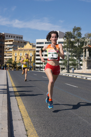 isabel: VALENCIA, SPAIN - MAY 15, 2016: Isabel Checa running the Volta a Peu Valencia Caixa Popular 8k run. Isabel won the womens division with a time of 28 minutes, 27 seconds. Editorial