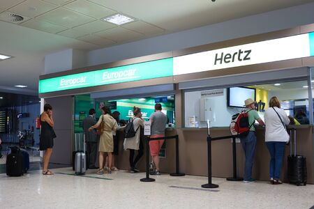 hertz: VALENCIA, SPAIN - JUNE 9, 2016: Rental car counter at the Valencia, Spain Airport. Approximately 4.98 million passengers passed through the Valencia airport in 2015.