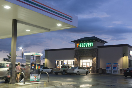 franchises: JACKSONVILLE, FLORIDA, USA - SEPTEMBER 19, 2016: A 7-Eleven convenience store and gas station in early evening. 7-Eleven is an international chain of convenience stores that operates, franchises and licenses some 56,600 stores in 18 countries.
