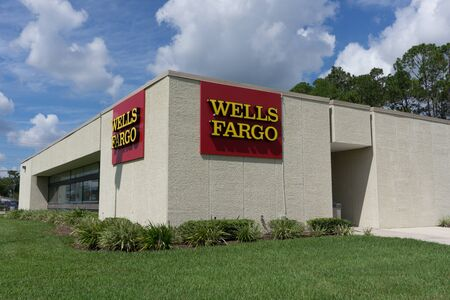wells: JACKSONVILLE, FLORIDA, USA - SEPTEMBER 25, 2016: A Wells Fargo Bank Branch in Jacksonville. Wells Fargo & Company was founded in 1929 and currently has 9,000 bank branches in 39 states.