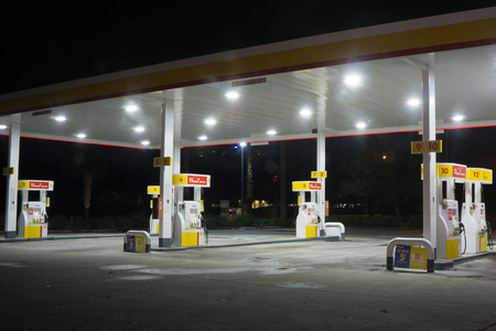 unleaded: JACKSONVILLE, FL-OCTOBER 8, 2016: A Shell gas station at night in Jacksonville. According to Forbes, Royal Dutch Shell oil company is the 5th largest company worldwide. Editorial