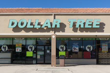 contiguous: JACKSONVILLE, FL-OCTOBER 9, 2016: A Dollar Tree store front in Jacksonville. Dollar Tree is an American chain of discount variety stores that sells items for $1 or less. Dollar Tree operates 13,600 stores throughout the 48 contiguous U.S. states and Canad