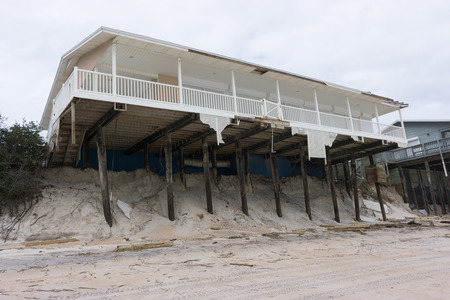 florida house: NORTH VILANO BEACH, FLORIDA, USA - OCTOBER 11, 2016: Aftermath of a beach house after Hurricane Matthew blew along the east coast of Florida on October 7, 2016.
