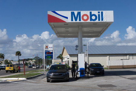 capitalization: JACKSONVILLE, FL-OCTOBER 18, 2016: A Exxon Mobil Gas Station. Exxon Mobil is the worlds 8th largest company by revenue and the fifth largest publicly traded company by market capitalization.