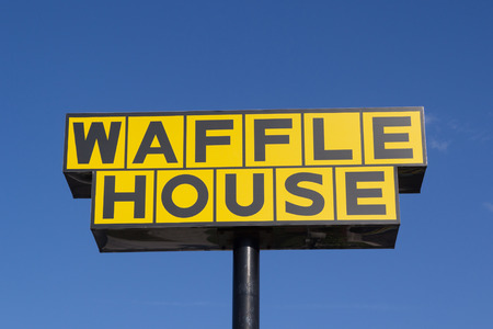 JACKSONVILLE, FL - OCTOBER 21, 2014: A Waffle House sign in Jacksonville. Waffle House Inc. is a restaurant chain with over 1700 locations found in 25 states in the United States.