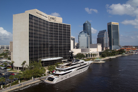 nfl football: JACKSONVILLE, FLORIDA - OCTOBER 26, 2016: View of downtown Jacksonville with the superyacht Kismet in foreground. Kismet is owned by billionaire Shahid Khan, also owner of the Jacksonville Jaguars NFL football team. Editorial