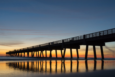 orange county: Jacksonville Beach Fishing Pier in the Early Morning Stock Photo