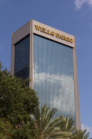 brokerage: JACKSONVILLE, FL- OCTOBER 26, 2016: The Wells Fargo Building in downtown Jacksonville. Wells Fargo & Company was founded in 1929 and currently has 9,000 bank branches in 39 states. Editorial