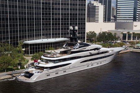 super yacht: JACKSONVILLE, FLORIDA - OCTOBER 26, 2016: The Kismet superyacht in downtown Jacksonville. Kismet is owned by billionaire Shad Khan, who is also the owner of the Jacksonville Jaguars NFL football team.