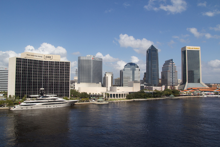 nfl football: JACKSONVILLE, FLORIDA - OCTOBER 26, 2016: View of downtown Jacksonville with the superyacht Kismet on the left. Kismet is owned by billionaire Shad Khan, who is also the owner of the Jacksonville Jaguars NFL football team.