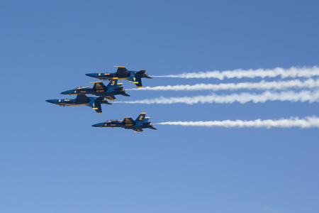 f18: JACKSONVILLE BEACH, FL - NOVEMBER 5, 2016: The United States Navy Blue Angels performing at the Jacksonville Sea and Sky Airshow. The Blue Angels team was formed in 1946, making it the second oldest formal flying aerobatic team (under the same name) in th Editorial