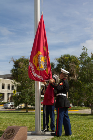 parades: JACKSONVILLE, FL- NOVEMBER 8, 2016: US Marines raising the Marine Corps flag during a ceremony at the Veterans Day Tribute and a Veterans Plaza Dedication in Jacksonville.