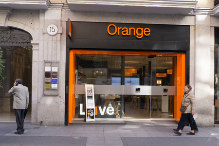 international internet: VALLADOLID, SPAIN - MARCH 17, 2017:  A Orange stroe front. Orange, a French telecommunications company, is one of the largest operators of mobile and internet services in Europe. Editorial