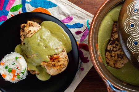 Green pipian (pipian or mole verde), traditional Mexican food. Traditionally from the states of Puebla, Tlaxcala and Oaxaca. Served in a traditional clay pot (cazuela) with chicken and rice.