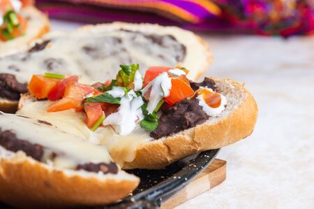 Molletes. Vegetarian Mexican food similar to bruschetta. Refried beans and melted cheese on toasted bread.