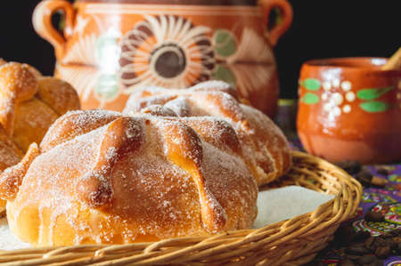 Traditional Mexican bread of the dead, pan de muerto, with coffee Stock Photo
