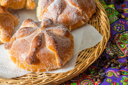 Traditional Mexican bread of the dead, pan de muerto, with coffee