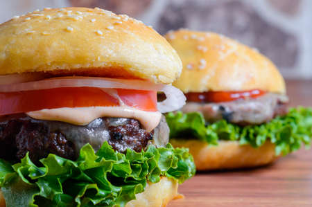Home made barbecue cheese burgers in brioche bread buns