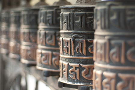 singing bowls: Close-up of rolls of prayer in Buddhist temples in Nepal