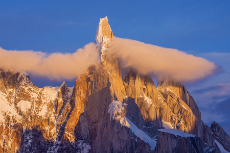 cerro torre: Sunrise colors the walls of Cerro Torre watching from the shores of Lake Torre Stock Photo