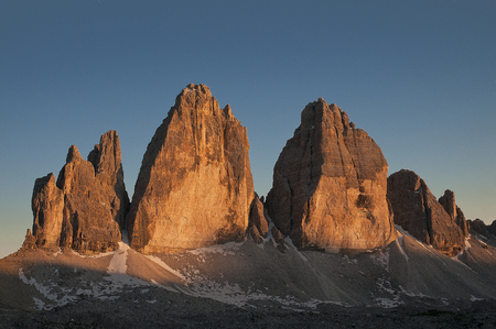 the last rays of the day light up the walls of the most famous peaks of the Dolomites