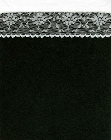 Image of lace border on black background photo