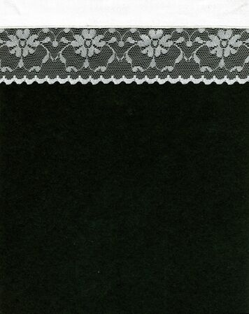 white trim: Image of lace border on black background