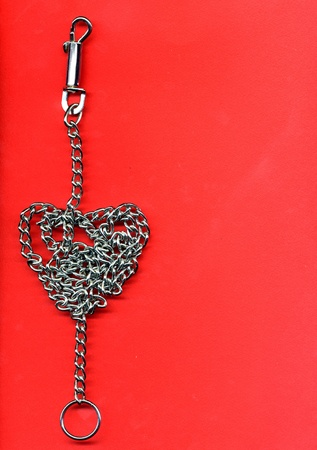 prisoner of love: chain rolled up on shape of a heart Stock Photo