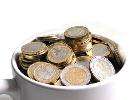Snapshot of white cup filled of euro coins Stock Photo - 8744908