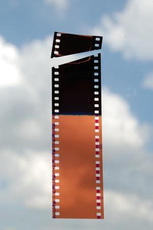 Film strip on sky background