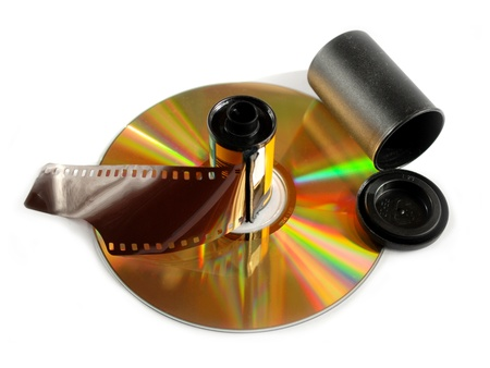 cd rom: Film roll and compact disk on white background Stock Photo