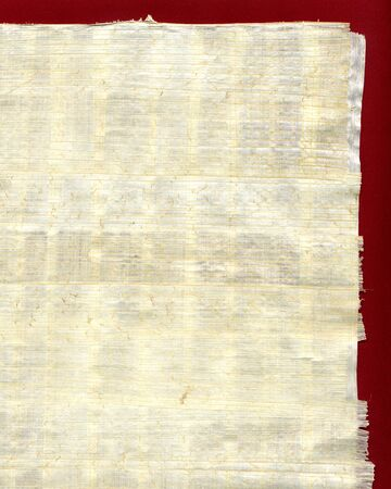Papyrus sheet of paper on red background
