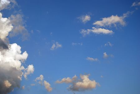 White little clouds in a blue sky Stock Photo