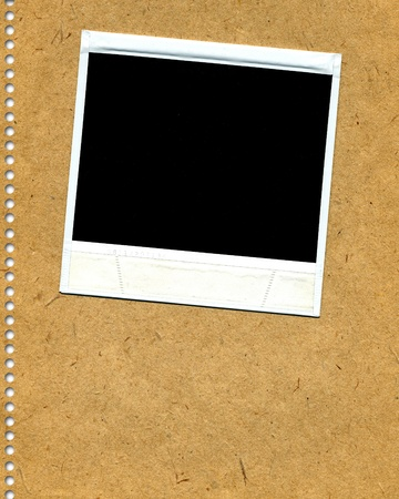 Blank polaroid film on neutral background