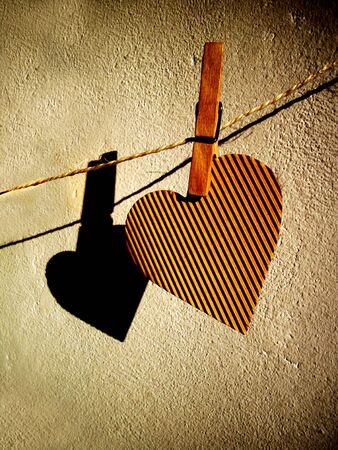 Paper heart hanging on the wire