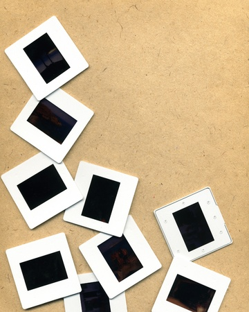 Scattered photographic slides on neutral background