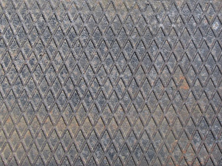metal grid from a manhole cover Stock Photo
