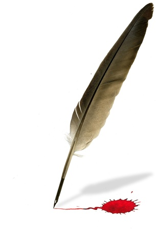 feather pen: Image of feather pen writing with blood