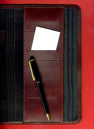 Image of a business card and pen placed on the agenda photo