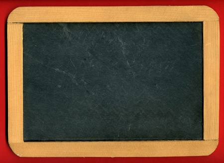 school aged: Image of little chalkboard on red background