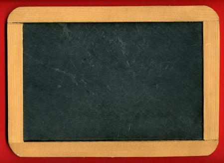 blank slate: Image of little chalkboard on red background