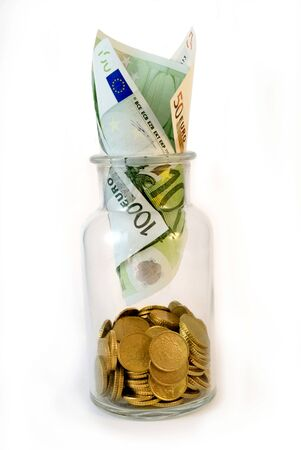 Jar filled with coins and banknotes (euro)