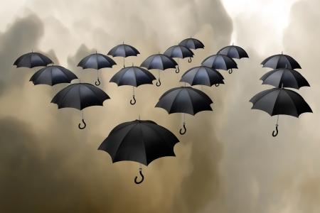 descend: 3d illustration flying umbrellas over storming sky background Stock Photo